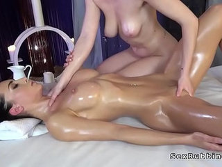Stunning brunette gets erotic lesbian massage