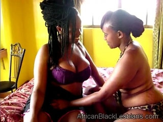 Gorgeous African babe seduced by chunky black lezzieedroom