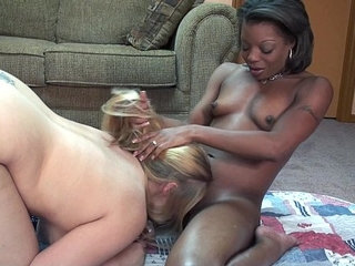 Gorgeous interracial lesbians with thick strapon fucking each other